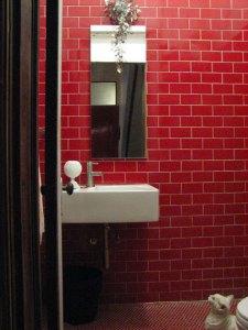 Photo:http://sunnysblog.typepad.com/mornings_light/2009/03/red-shower-room.html